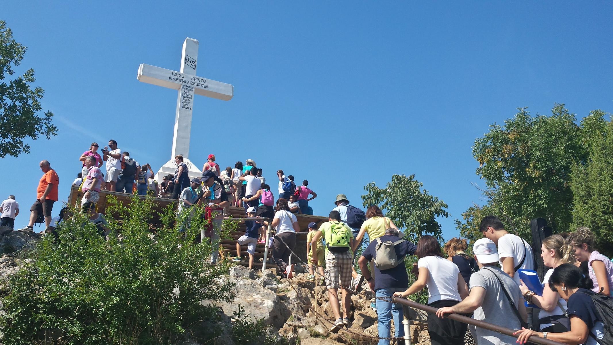 Pilgrims climbing the Hill of the Cross